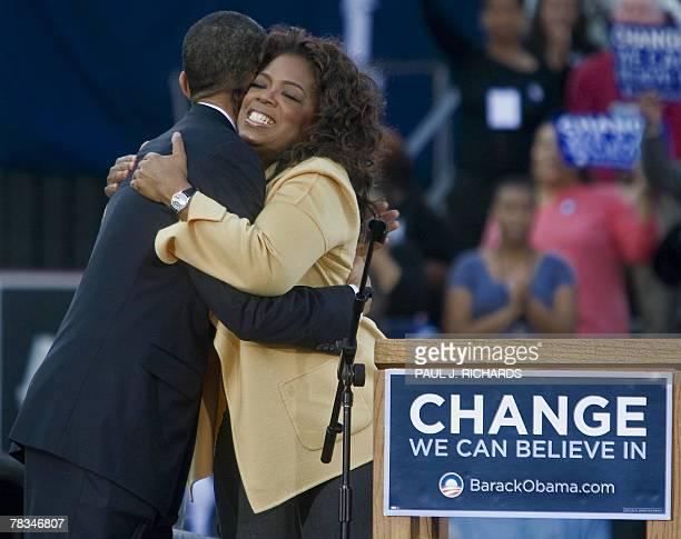 Illinois Senator and Democratic presidential hopeful Barack Obama gets a hugs from television host Oprah Winfrey 09 December 2007 inside the...