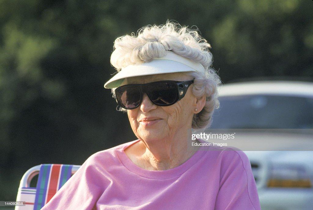 Illinois, Senior Woman Wearing Sun Visor And Wrap Sunglasses. News Photo -  Getty Images
