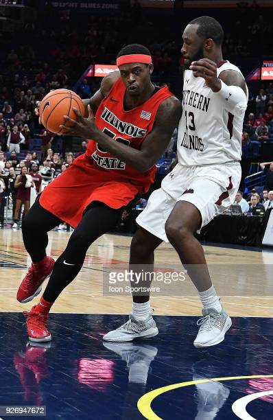 Illinois State guard Milik Yarbrough drives to the basket against Southern Illinois guard Sean Lloyd during a Missouri Valley Conference Basketball...