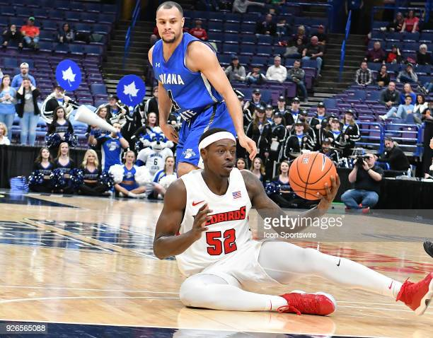 Illinois State guard Milik Yarbrough falls to the court buts hangs on to the ball during a Missouri Valley Conference Basketball Tournament game...