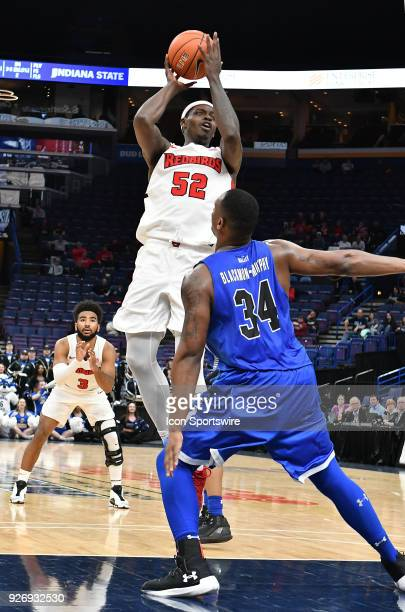 Illinois State guard Milik Yarbrough shoots over Indiana State center Brandon Murphy during a Missouri Valley Conference Basketball Tournament game...