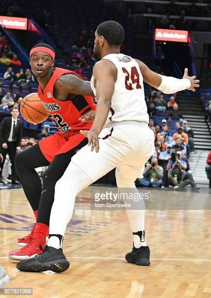 Illinois State guard Milik Yarbrough tries to drive around Loyola guard Andre Jackson during a Missouri Valley Conference Basketball Tournament game...