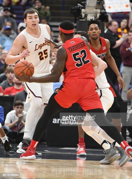 Illinois State guard Milik Yarbrough works in for a shot against Loyola guard Cameron Krutwig during a Missouri Valley Conference Basketball...