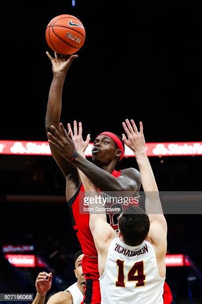 Illinois State Redbirds forward Milik Yarbrough back goes up for a shot over Loyola Ramblers guard Ben Richardson during the first half of a Missouri...