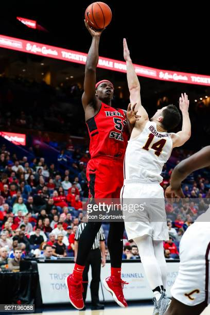 Illinois State Redbirds forward Milik Yarbrough left goes up for a shot over Loyola Ramblers guard Ben Richardson during the first half of a Missouri...