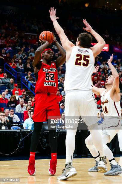 Illinois State Redbirds forward Milik Yarbrough left takes a shot in front of Loyola Ramblers center Cameron Krutwig during the first half of a...