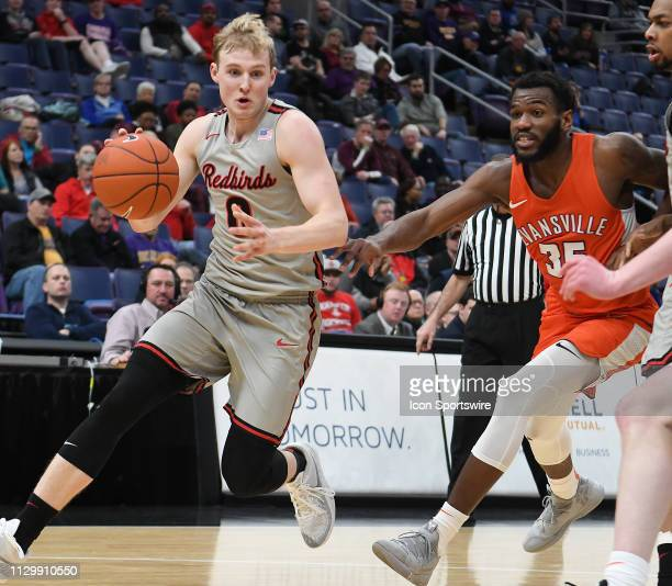 Illinois State Redbirds guard Isaac Gassman drives around Evansville Purple Aces forward John Hall to the basket during a Missouri Valley Conference...