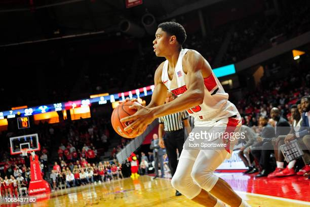 Illinois State Redbirds guard William Tinsley shoots a three point shot during the college basketball game between the Brigham Young Cougars and the...