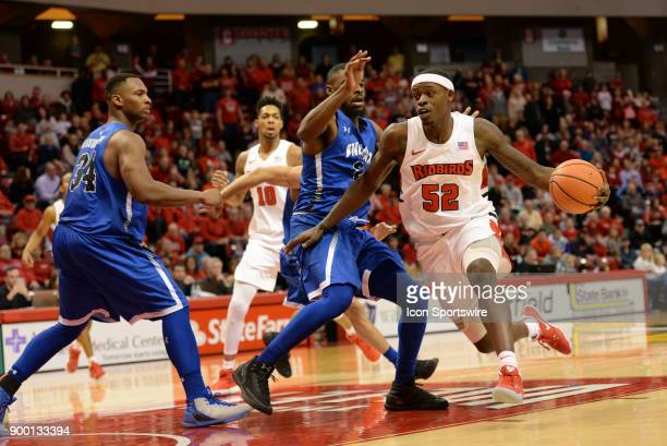 Illinois State University Redbirds forward Milik Yarbrough dribbles into Indiana State Sycamores Guard Qiydar Davis during the Missouri Valley...