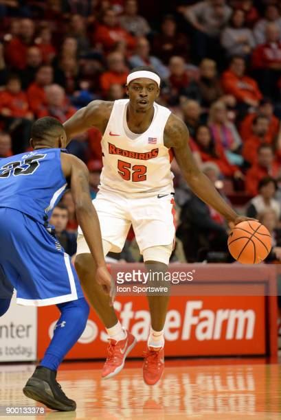 Illinois State University Redbirds forward Milik Yarbrough looks to get the ball past Indiana State Sycamores Guard Qiydar Davis during the Missouri...