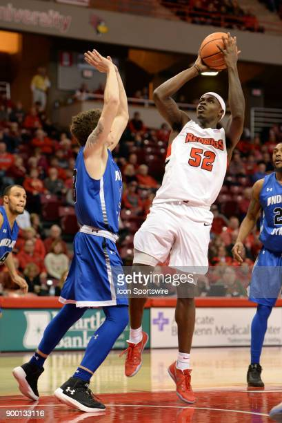 Illinois State University Redbirds forward Milik Yarbrough shoots a fade away jump shot over Indiana State Sycamores Guard Clayton Hughes during the...