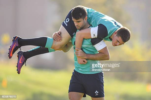 Illinois United States 3 November 2016 Conor Murray of Ireland carries teammate Garry Ringrose during squad training at University of Illinois in...
