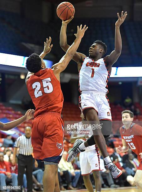 IllinoisChicago Flames guard Michael Kolawole shoots over Detroit Titans forward Gerald Blackshear during a NCAA basketball game between the Detroit...