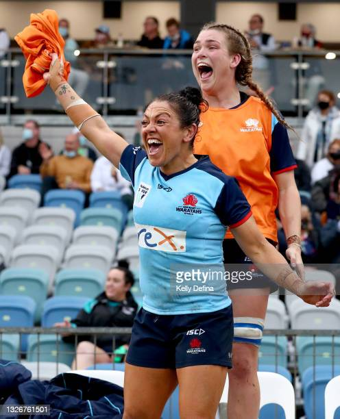 Illiseva Batibasaga of the Waratahs and Kaitlan Leaney of the Waratahs react during the Super W Final match between the NSW Waratahs and the...