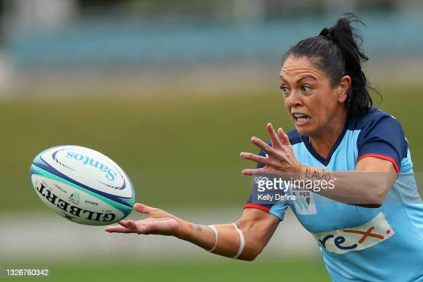 Illiseva Batibasaga of the Waratahs passes during the Super W Final match between the NSW Waratahs and the Queensland Reds at Coffs Harbour...