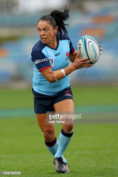 Illiseva Batibasaga of the Waratahs runs with the ball during the Super W Final match between the NSW Waratahs and the Queensland Reds at Coffs...