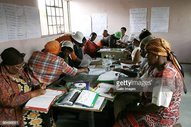 Illiterate South African women take part in the Kha ri gude literacy classes on November 25 2009 in Kliptown South Africa Started in 2008 by the...