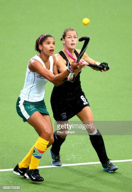Illse Davids of South Africa is challenged by Petrea Webster of New Zealand in the Women's Bronze Medal Match at Glasgow National Hockey Centre...