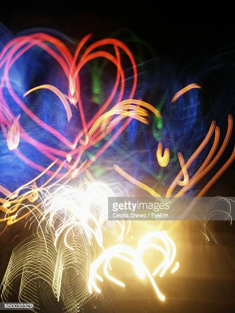 Illuminated Abstract Colorful Light Painting Against Black Background