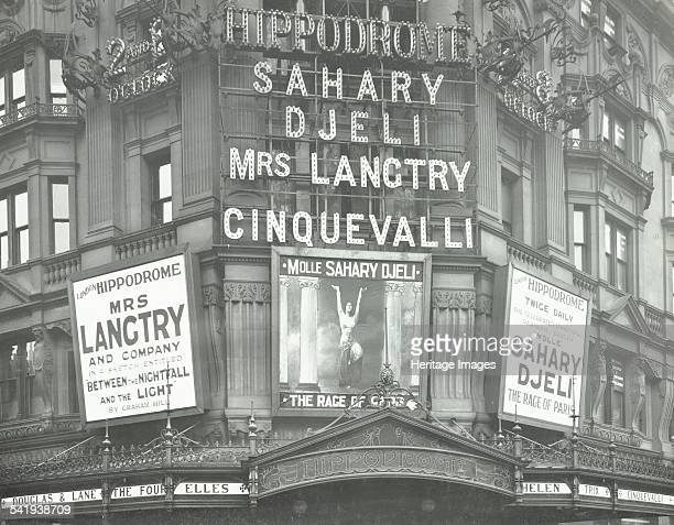 Illuminated advertisements on the front of The Hippodrome theatre Charing Cross Road London 1911 The advertisements above the entrance are for...