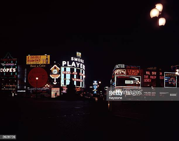 Illuminated advertisements surrounding the statue of Eros in Piccadilly Circus, London.