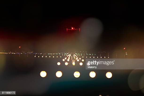 Illuminated Airport Runway At Night
