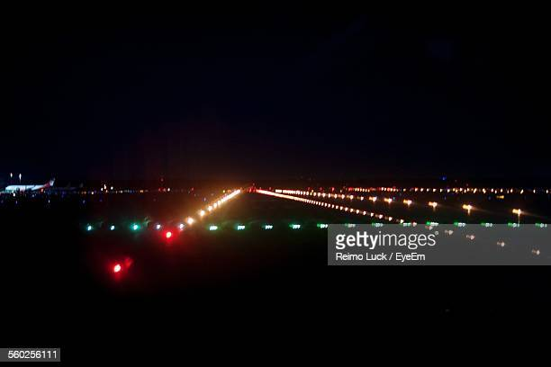 Illuminated Airport Runway At Night