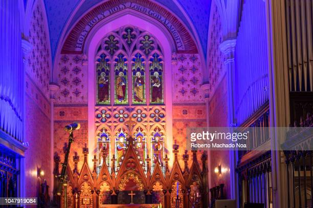 Illuminated altar of the Holy Trinity Anglican Church. The small church has a Gothic Revival architecture and it is part of the city heritage.