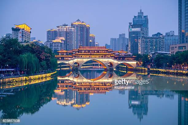 Illuminated Anshun Bridge with reflection, Chengdu