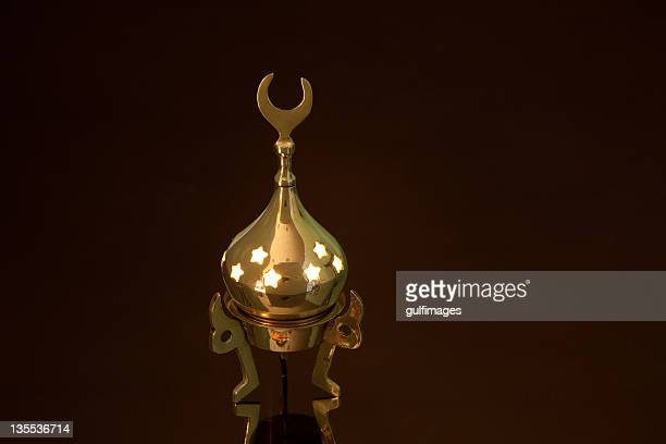 Illuminated Arabic style bronze metallic lantern