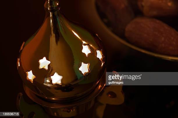 Illuminated Arabic style bronze metallic lantern with dates
