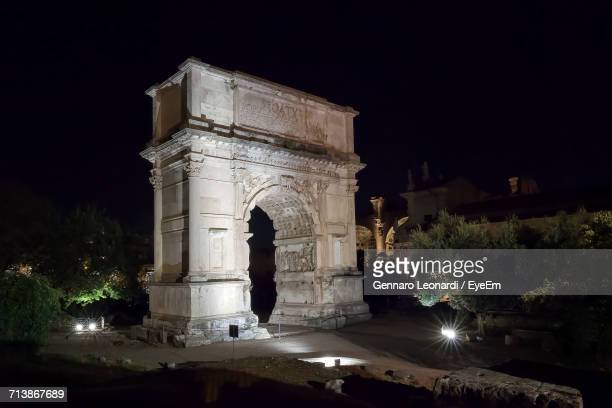 Illuminated Arch Of Titus Against Sky At Night