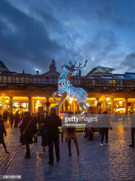 illuminated artificial reindeer in covent garden - covent garden stock pictures, royalty-free photos & images