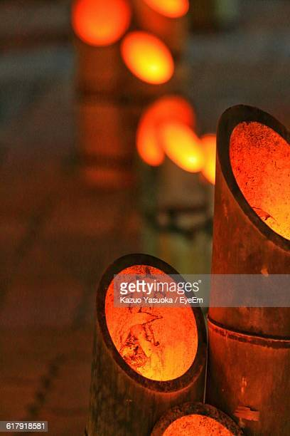 illuminated bamboo lanterns at bon festival against black background - black bamboo stock pictures, royalty-free photos & images