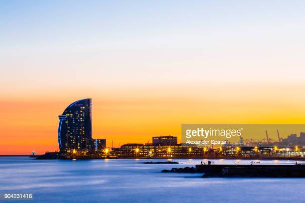 illuminated barcelona skyline at dusk - barcelona spain stock photos and pictures