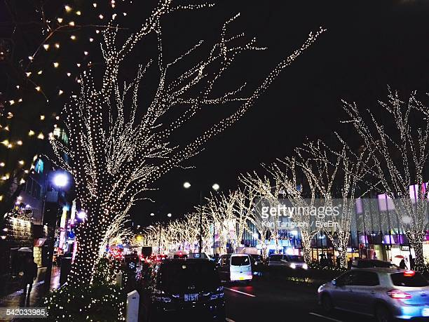 Illuminated Bare Trees At City Street During Christmas