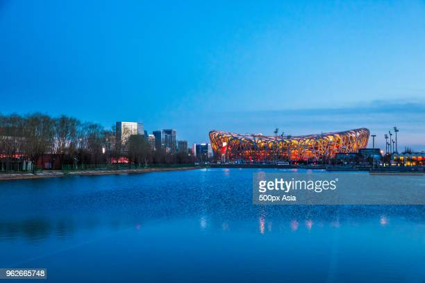 illuminated beijing national stadium and olympic pool at night, beijing, china - image stock pictures, royalty-free photos & images