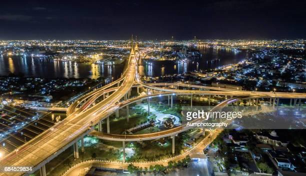 Illuminated Bhumibol Bridge over Chao Phraya River at night.