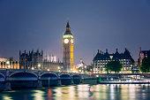 Illuminated Big Ben and Westminster Bridge at night