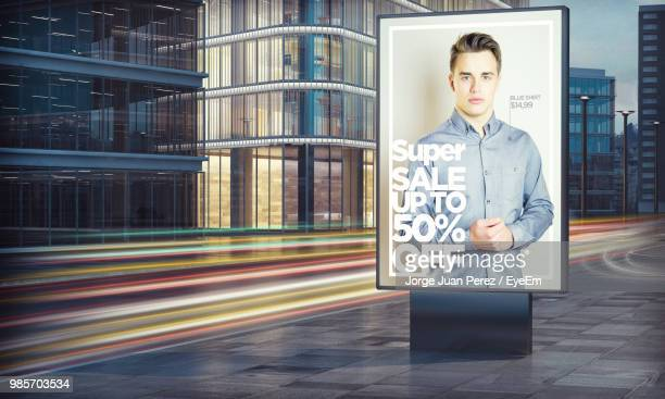 illuminated billboard in city at night - fast fashion stock pictures, royalty-free photos & images