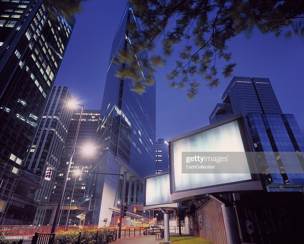 illuminated billboards in a modern business district, low angle view : Photo