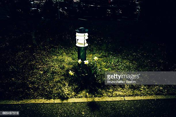 Illuminated Bollard On Grassy Field