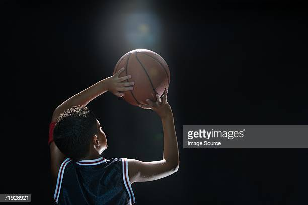 Illuminated boy with basketball