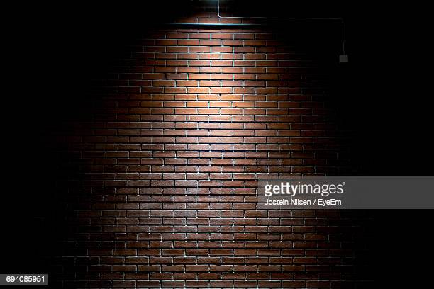 illuminated brick wall - brick wall stock pictures, royalty-free photos & images