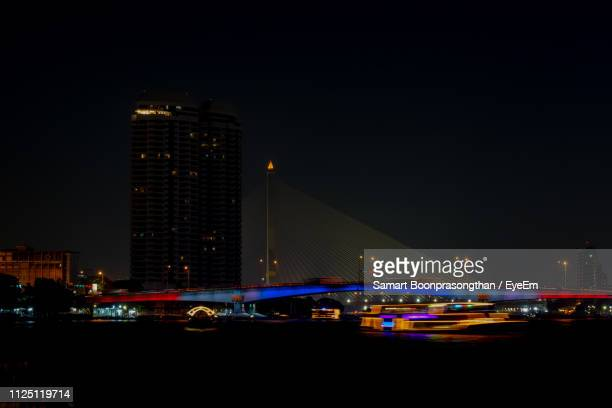 illuminated bridge and buildings against sky at night - {{relatedsearchurl('london eye')}} stock photos and pictures