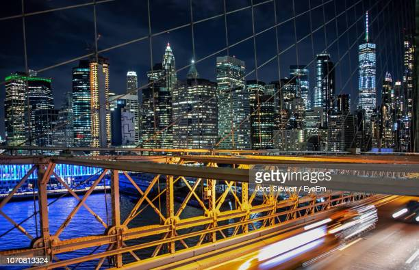 illuminated bridge and buildings in city at night - jens siewert stock-fotos und bilder