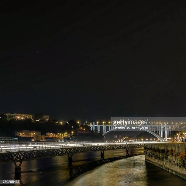 illuminated bridge over river against sky at night - special:whatlinkshere/file:lucerne_circle,_orlando,_fl.jpg stock pictures, royalty-free photos & images