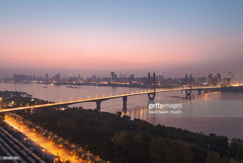Illuminated Bridge Over River Against Sky At Sunset : Stock Photo