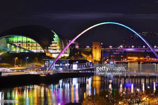 illuminated bridge over river at night - tyne and wear stock pictures, royalty-free photos & images