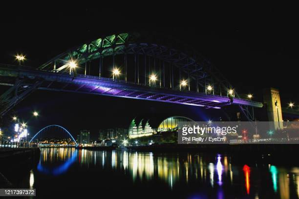 illuminated bridge over river at night - premiere stock pictures, royalty-free photos & images